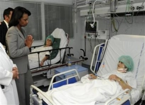 U.S. Secretary of State Condi Rice visits an old woman who has been brutalized by Russian aggression in Georgia