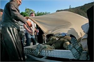 In Gori, the bodies pile up in heaps in a pickup truck