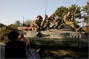 As Russian tanks roll in, Georgian women beg for mercy