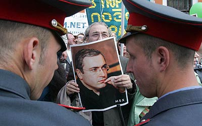 Perhaps soon, it will be Putin's goons who brandish Khodorkovsky's picture?