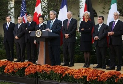 President Bush makes a statement in the Rose Garden of the White House after meeting with G7 finance ministers about the financial crisis, Saturday, Oct. 11, 2008, in Washington. Seen from left to right listening are central bank governor Mario Draghi of Italy; IMF Managing Director Dominique Strauss-Kahn; Eurogroup Chairman Jean-Claude Juncker; Japanese Finance Minister Shoichi Nakagawa; U.S. Treasury Secretary Henry Paulson; French Finance Minister Christine Lagarde; Canadian Finance Minister James M. Flaherty, and British Chancellor of the Exchequer Alastair Darling