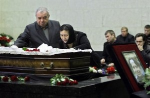 Eduardr and Larisa Baburov pay last respects to their daughter Anastasia Baburova, who was shot dead with human-rights lawyer Stanislav Markelov, in Moscow, Friday, Jan. 23, 2009.