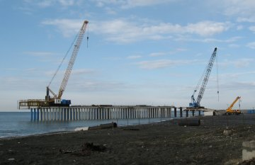 Building of a freight port has begun: some piles have been driven into the seabed