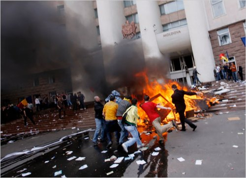 Anti-communist protesters light a bonfire on the steps of their parliament in Moldova