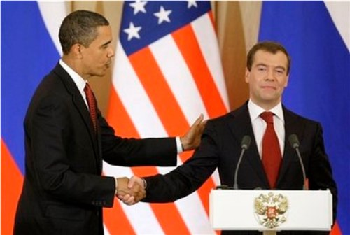 Putin seems to have been a little slow turning Medvedev's head to the right on this one. Based on that facial expression, Does Putvedev think he/it has a live one?